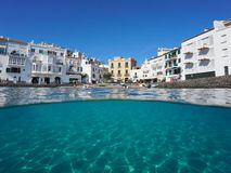 Waterfront village Cadaques and sandy seabed Spain Stock Photography
