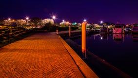 Waterfront walkway at the Bay Bridge Marina at night, in Kent Is Stock Images