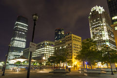 Waterfront walkway and view of the Exchange Place in Jersey City, New Jersey at night Royalty Free Stock Photos