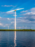 Waterfront wind turbine in polder, Holland Royalty Free Stock Images