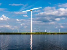 Waterfront wind turbine in polder, Holland Royalty Free Stock Photo