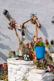 Waterhole. Rustic waterhole well adorned with plants and flowers Stock Images