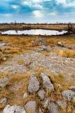 Waterhole vuoto nella riserva di caccia della Namibia Fotografia Stock