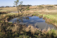 Waterholes Rural Farming. Rural farming landscape terrain waterholes catchment for rain season Royalty Free Stock Image