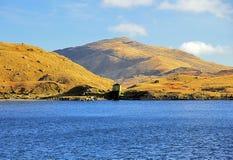 Waterhouse and Carnedd y Cribau across Llyn Llydaw. Snowdonia Wales stock photography