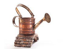 Watering. Of brass for water on a wooden bridge on a white background Stock Photography
