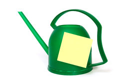 Watering-can. Green watering-can with blank yellow mark Royalty Free Stock Image