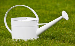 Watering can. Old watering can in the grass Royalty Free Stock Photography