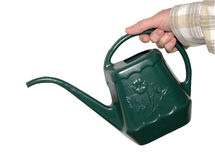 Watering Can. Woman holding a green watering can royalty free stock photography