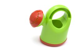 Watering Can. A colorful plastic watering can isolated on a white background Royalty Free Stock Photography