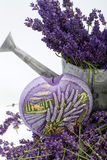 Watering Can, Candle and Lavender Stock Images