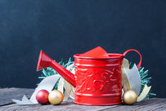 Watering can and christmas decoration Royalty Free Stock Image