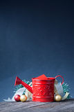 Watering can and christmas decoration Stock Images