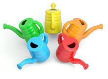 Watering can of different colors Royalty Free Stock Photo