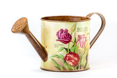 Watering can with flower pattern stock photography