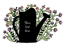 Watering can with flowers in the background Stock Photography