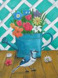 Watering can with flowers and blue jay bird Royalty Free Stock Image