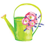 Watering can with flowers Royalty Free Stock Photos