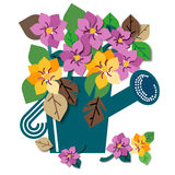 Watering can full of spring flowers Royalty Free Stock Image