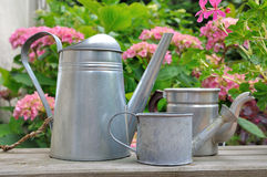 Watering can in garden Royalty Free Stock Photo