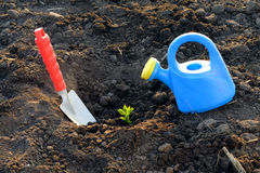 Watering can and garden shovel Stock Images