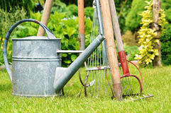 Watering can and garden tools Royalty Free Stock Images