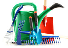 Watering can and garden tools on white Stock Image