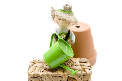Watering can with gardener doll Stock Photography