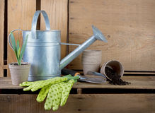 Watering can and gardening tools on wooden crates Royalty Free Stock Photos