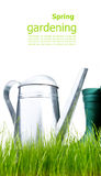 Watering can with grass and garden tools Stock Photography