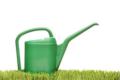 Watering can on a green grass Stock Images