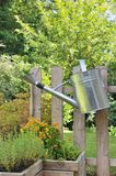 Watering Can In Rustic Garden Stock Image
