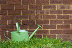 Watering Can. A watering can outside in a garden Stock Image