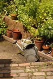 Watering can on patio B Royalty Free Stock Photo