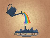 Watering can with rainbow Royalty Free Stock Photography