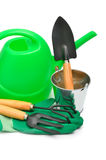 Watering-can, rake, pot, rubber gloves Royalty Free Stock Photography