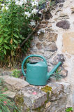 Watering can at the tap Stock Image
