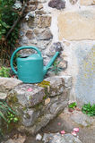 Watering can at the tap Stock Photos