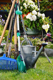Watering can and tools in the garden Royalty Free Stock Images