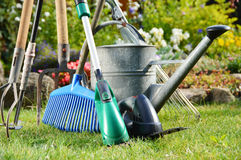 Watering can and tools in the garden Stock Photography