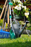 Watering can and tools in the garden Royalty Free Stock Photography