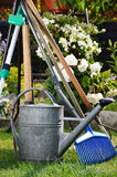 Watering can and tools in the garden Stock Photo