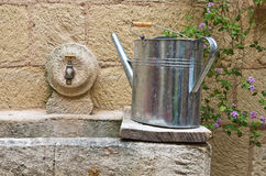 Watering can on washhouse. Stock Image