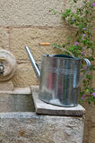 Watering can on washhouse. Stock Photo