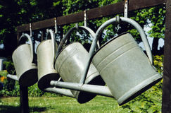 Watering cans. In a cemetery in Leipzig, Germany Royalty Free Stock Photos