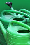 Watering cans. Green watering cans Royalty Free Stock Photos