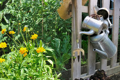 Watering cans in garden Stock Image