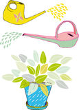 Watering cans and leaves Stock Photos