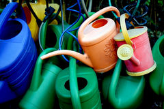 Watering cans. Some watering cans on a graveyard stock images