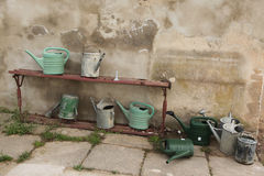 Watering cans at the town cemetery in Terezin. Stock Photography